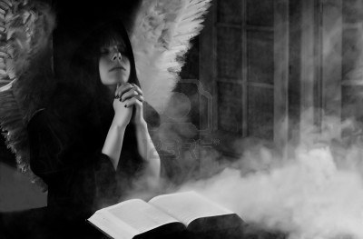 7995073-angel-with-white-wings-praying-with-mysterious-book-opened-and-smoke-in-the-air