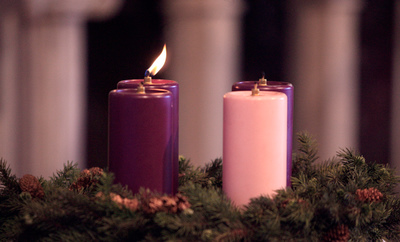 CANDLE IN ADVENT WREATH PICTURED DURING MASS AT MARYLAND CHURCH