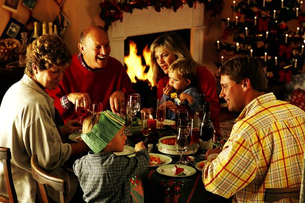 Family eating Christmas dinner-1465996