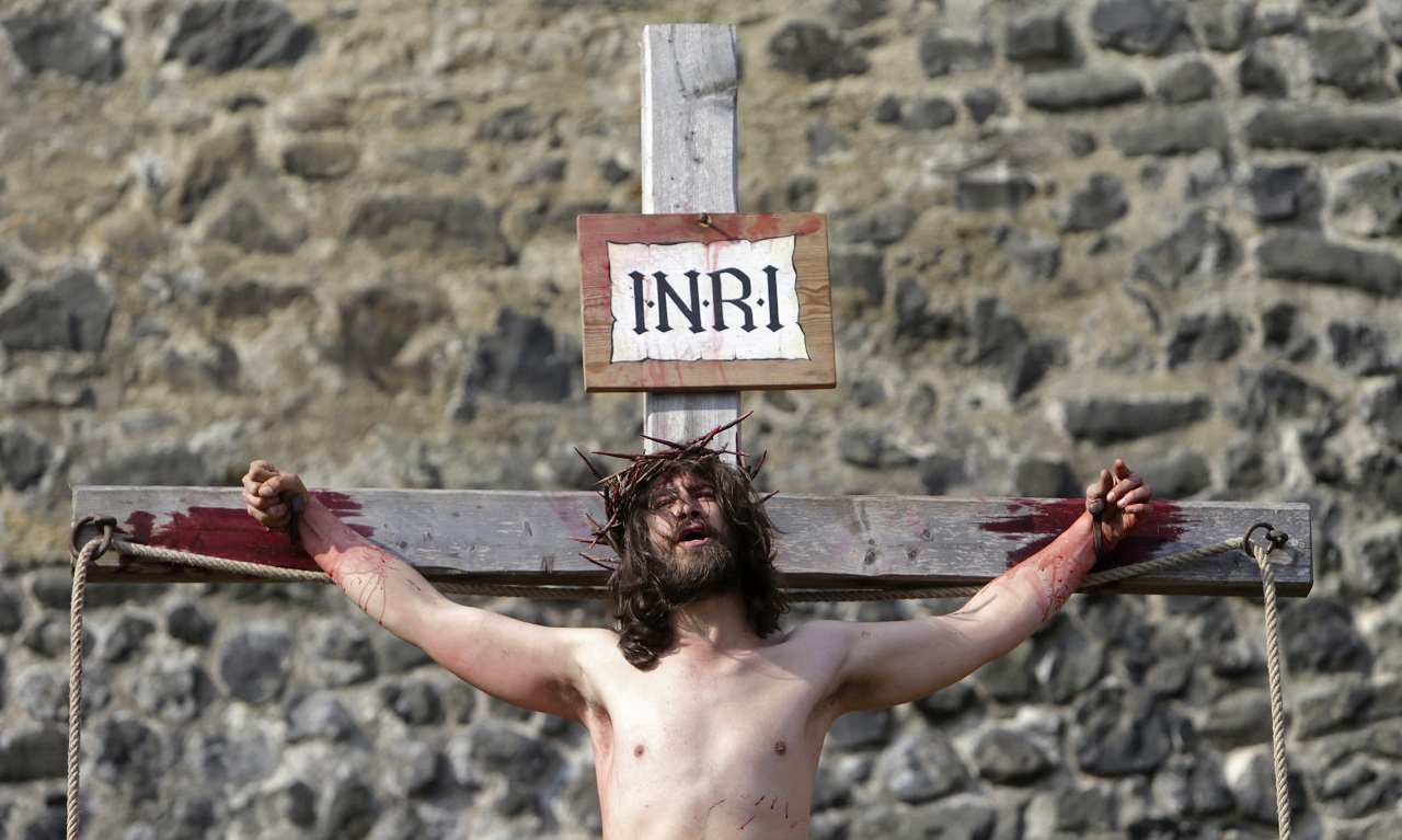 "An actor portraying Jesus Christ performs the crucifixion scene during ""the Passion of Christ"" play in Ceska Lipa"