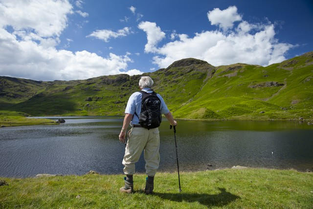 Tourist at Easedale Tarn, The Lake District, UK