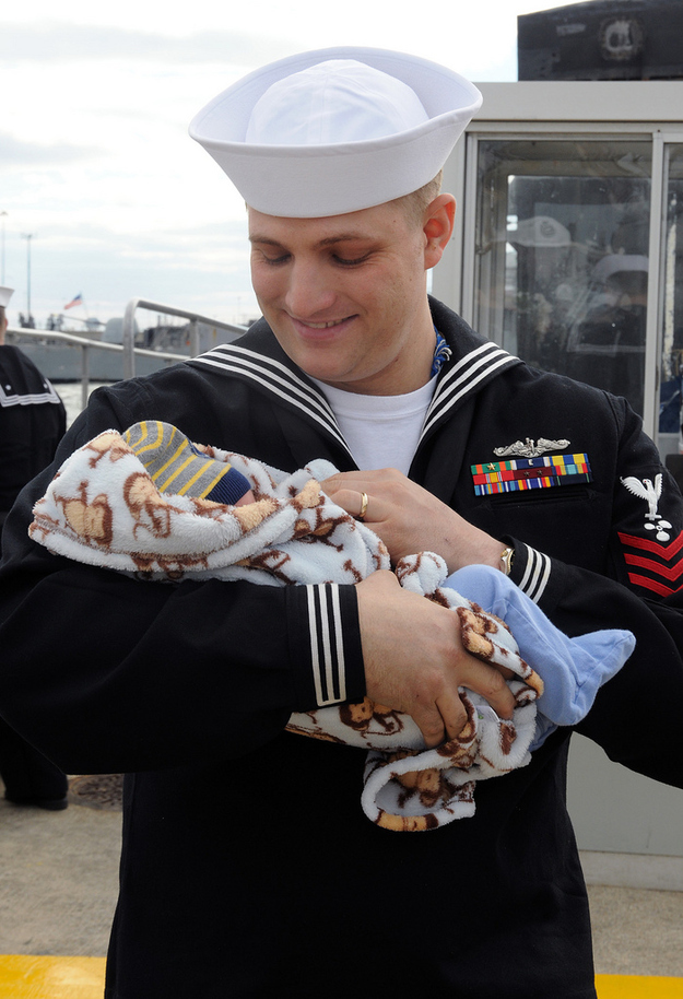A-USS-Norfolk-sailor-holds-his-newborn-son.