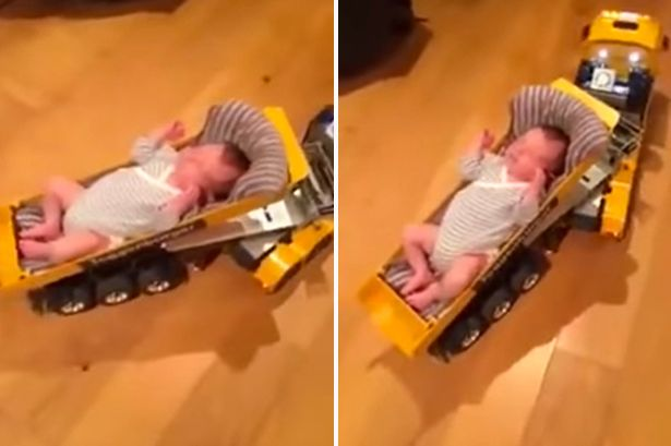 TEASER-dad-rocks-baby-to-sleep-on-toy-car
