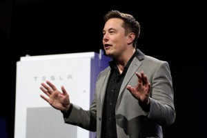 "Tesla Motors CEO Elon Musk unveils large utility scale home batteries at the Tesla Design Studio in Hawthorne, California, April 30, 2015.  Electric car pioneer Telsa Motors unveiled a ""home battery"" Thursday which its founder Elon Musk said would help change the ""entire energy infrastructure of the world.""      AFP PHOTO / David McNew"