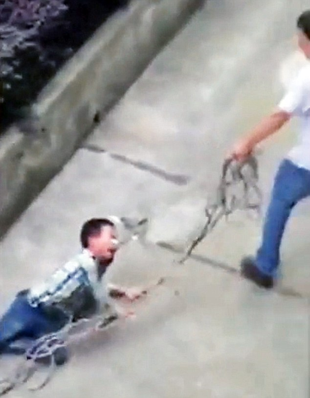 "Pic shows: The father ticking off his son on a rope around his neck. A video has gone viral showing a father angrily dragging his son by a rope around his neck for several metres because his son was allegedly misbehaving and refused to study. The angry father was filmed by a local in Jinhua City, east China's Zhejiang Province, when he forced his 10-year-old son out of his car by a rope and dragged him dozens of metres to their home. The boy can be seen crying and screaming as his father says: ""I might as well treat you like a dog"". The video had been shot by local Chan Fu who said: ""I heard a child screaming and when I looked I saw the man trying to drag the child out of the car and he was clearly refusing to go. I grabbed my telephone and started filming it because I wanted to give it to the police."" She had then also uploaded it online where it quickly went viral. According to the father, who was later approached by police, he had lost his temper because his son was out playing when he should have been studying. He apologised to authorities and admitted that his methods were inappropriate. He will not charged by police but has received a stern warning not to repeat the action the action. (ends)"
