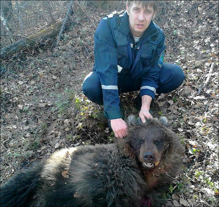 inside_hunter_holds_bear
