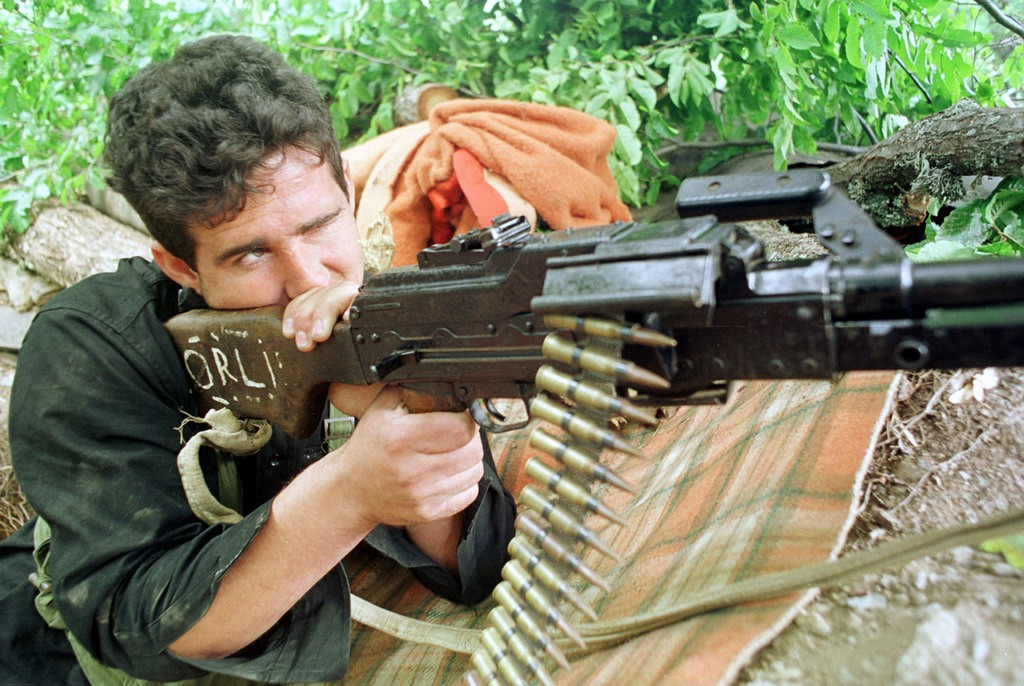 390977 07: A National Liberation Army solider keeps watch from a check-point June 21, 2001 outside the village of Matejce, Macedonia. Clashes continue between the Albanian fighters and Macedonian military forces in what the NLA is calling a war for equal rights within Macedonian society. (Photo by David Greedy/Getty Images)