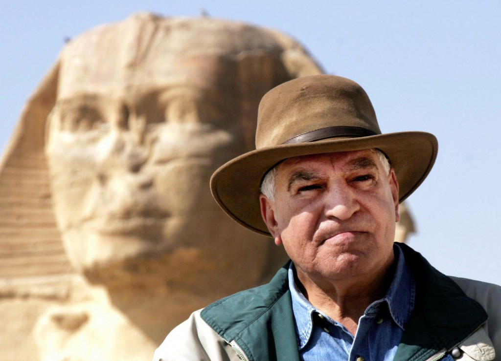 FILE - In this March 11, 2007 file photo, Zahi Hawass, Egypt's top antiquities official, poses in front of the ancient Sphinx in Giza, Egypt. Antiquities Minister Zahi Hawass was convicted Sunday, April 17, 2011 of failing to implement a court order in a dispute with a businessman over the use of space in a museum gift shop. He was sentenced to a year in prison but is appealing the verdict.  (AP Photo/Amr Nabil, File)