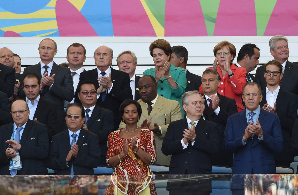 (From back L-R) Russian President Vladimir Putin, FIFA President Joseph Blatter, Brazilian President Dilma Rousseff, German Chancellor Angela Merkel and Jordanian Prince Ali Bin al-Hussein (C-L), Ali Bongo Ondimba (C), Hungarian Prime Minister Viktor Orban (C-R) attend the closing ceremony ahead of the final football match between Germany and Argentina for the FIFA World Cup at The Maracana Stadium in Rio de Janeiro on July 13, 2014.  AFP PHOTO / PEDRO UGARTE