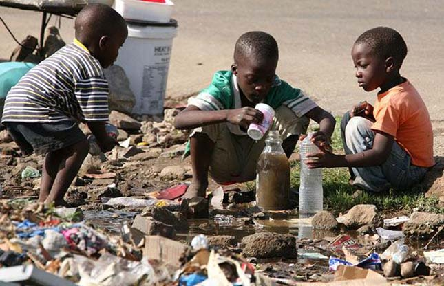 Children collect stagnant water for use at home in Glen View, Harare, Sunday, Dec.<div class='article-ad'><script src=