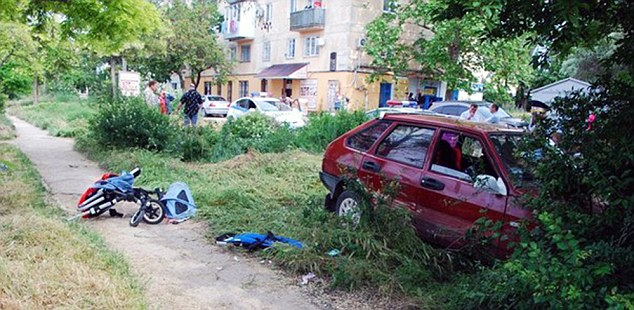 "Pic shows: Where the accident happened. Baby twins miraculously escaped death after being run down by a drunk driver. The one-year-old toddlers were being taken for a walk in a park with their mum pushing them in a pram when the drunk Lada driver came careering across the grass towards them in the city of Sevastopol in Crimea. As the horrified mum tried to drag her twins to safety the car slammed into the pram sending it somersaulting through the air and the toddlers flying onto the ground. Stunned eye witness Marina Matveeva, 54, said: ""I was going for a walk when I saw this car suddenly go onto the grass and head towards the mum and her children. ""When it hit them, the stroller went spinning through the air and one of the babies landed very near to the car's rear wheel. ""The driver was about to reverse, but the mother screamed so loudly he stopped. ""If he hadn't he would have surely crushed the baby."" As the mum ran to help her bleeding and crying tots passersby phoned the police and an ambulance. A police spokesman said that when officers arrived five minute later they found the mum cradling her twins and sobbing as the drunk sat behind the wheel of his motor. He was given a breath test and found to be 10 times over the limit. The babies were taken to hospital where their condition is said to be stable. The drunk driver now faces charges of drink driving and endangering the lives of others. (ends)"