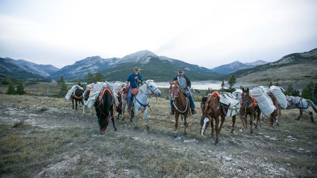 FLATHEAD NATIONAL FOREST, MONT.- Andy and Chuck lead their string of packed horses through the Montana wilderness.  (Photo Credit: © National Geographic Channels/ Peter Bobrow)