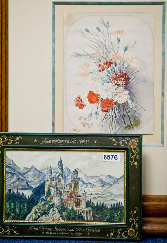 epa04794971 The watercolour paintings 'Nelkenstrauss' (back, lit. bouquet of carnations) and 'Neuschwanstein - Zum 80.' (lit. Neuschwanstein [castle] - to the 80th [birthday]) which are attributed to Adolf Hitler are on display at an auction house in Nuremberg, Germany, 12 June 2015. The painting will go under the hammer at the auction house Weidler on 20 June 2015.  EPA/DANIEL KARMANN