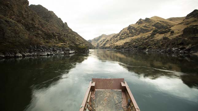 HELLS CANYON, IDAHO- Cruising along the sun-drenched Snake River, close shots taken on board Brice's boat.  (Photo Credit: © National Geographic Channels/ Peter Bobrow)
