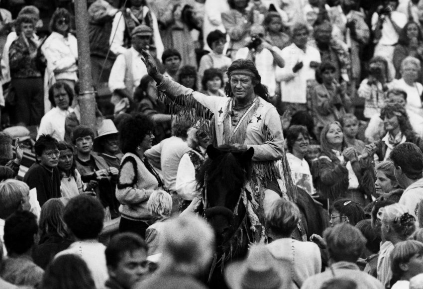 "French actor Pierre Brice, 62,  in the role of Winnetou, the fictional Apache chief, waves goodby to his fans after the theater production of the Karl May novel ""Winnetous letzter Kampf"" (Winnetou's Last Fight) for the outdoor Karl May Festspiele (theater festival) in Bad Segeberg, West Germany, September, 1990. Brice announced he is tired of the winnetou role and will quit playing it. (AP Photo/Christian Eggers)"