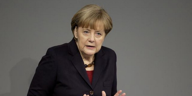 German Chancellor Angela Merkel gestures during her government declaration as part of a meeting of the German federal parliament, Bundestag, in Berlin, Germany, Thursday, Dec. 18, 2014. (AP Photo/Michael Sohn)