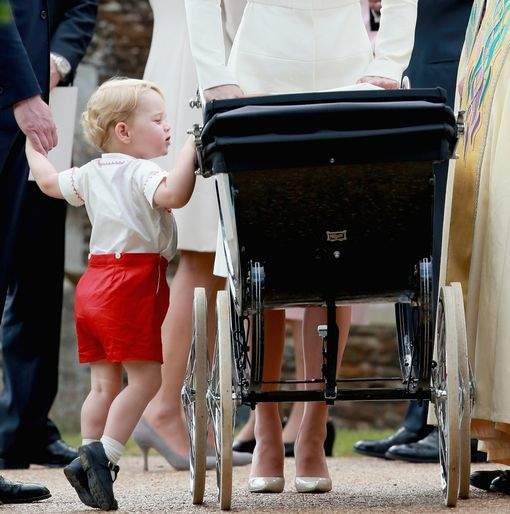 Prince-George-looks-in-the-pram-with-his-sister-Princess-Charlotte-in