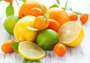 Citrus fresh fruit on the white wooden table