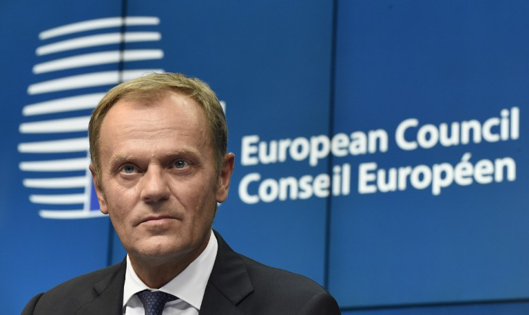 Polish Prime Minister Donald Tusk poses after being named new EU Council president during a European Union summit at the EU Headquarters in Brussels on August 30, 2014. European leaders named Tusk as the next EU president and Italian Foreign Minister Federica Mogherini to head the bloc's foreign service. AFP PHOTO/JOHN THYS