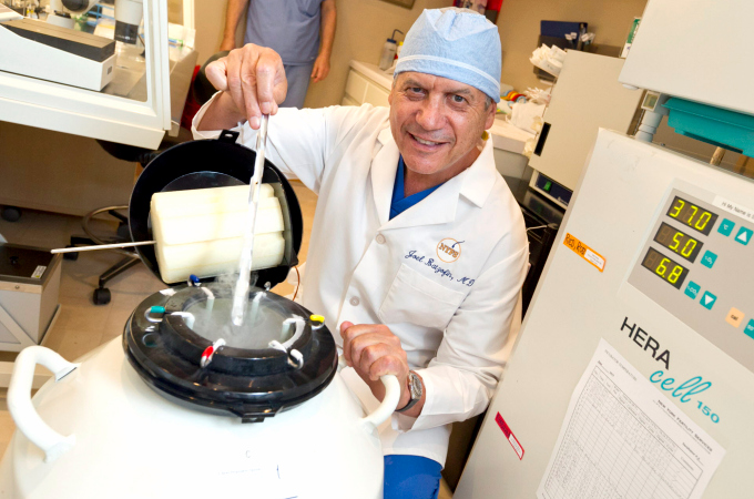 NEW YORK - JUNE 26: For Pulse, gender selection. Dr. Joel Batzofin is pictured submerging cryo-vials into a liquid nitrogren storage tank in the IVF lab at New York Fertility Services on June 26, 2015. (Anne Wermiel/NY Post)