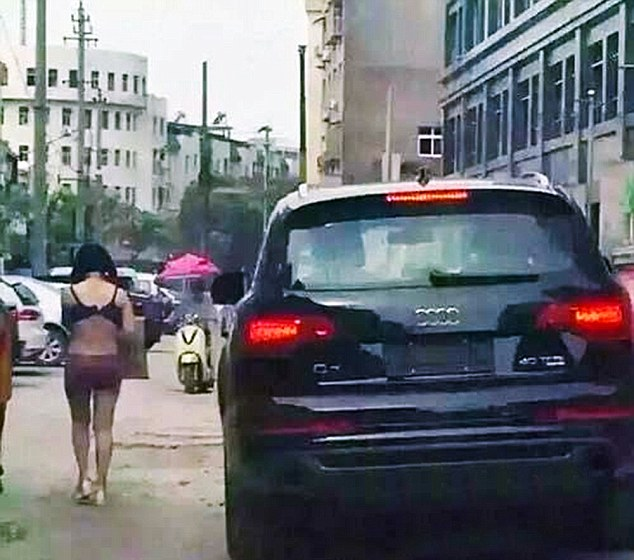"Pic shows: The naked wife walking on the street. A man has penned an official apology to his local newspaper for drunkenly beating his wife and forcing her to parade through the city streets half naked after deciding she had been unfaithful. Wang Ni, 33, was seen wearing only her underwear while walking through traffic in Yushan County of southeast China's Jiangxi Province, and holding up a sign that read, ""I want to sell my body"". Wang had allegedly been beaten by her husband Zhang, 37, after which she was forced to parade through the streets half naked. The husband was reportedly following her in his car to make sure she continued on the walk of shame. The couple have two daughters but the husband works long hours and has little time for their relationship, and even lives in another city where he runs a property development company. According to friends of the couple, he blamed his wife for the fact that despite 10 years of marriage she had given him two daughters and no sons - causing frequent rows that had split the family and meant that he often abused his wife on the few occasions when he did return home. But that abuse reached a new high when he returned home for a rare visit and decided to go out drinking with his friends who spread rumours that Wang was cheating on him with another man. Upon hearing the rumours, the drunken Zhang charged home and after beating Wang, and accusing her of being unfaithful, stripped her and forced her onto the streets with the sign. After police officers rescued the unfortunate woman and took her back to the police station, they called Zhang in for questioning. The result of the questioning was proof that the young woman had not been unfaithful and that her husband simply listened to malicious rumours with no foundation. Zhang later apologised to Wang and penned a formal apology in his local newspaper. It is not clear whether his wife has accepted his apology. (ends)"