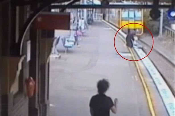 Woman-saves-schoolgirl-from-train-tracks-with-seconds-to-spare (1)