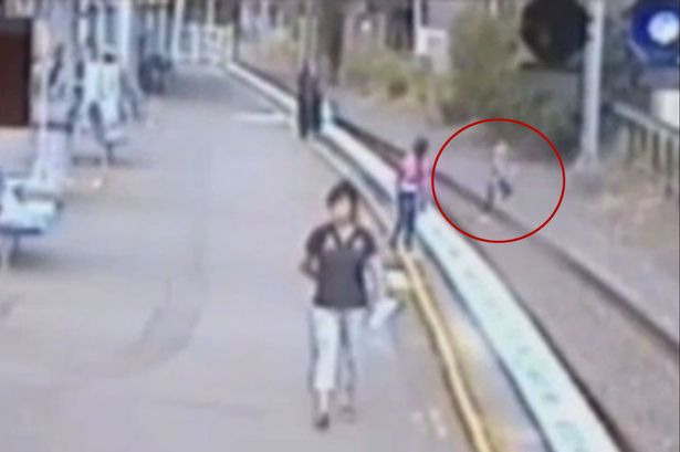 Woman-saves-schoolgirl-from-train-tracks-with-seconds-to-spare