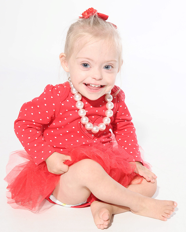 "Connie Rose Seabourne, aged 2, who was diagnosed with Down's Syndrome at her home in Morley, Leeds, West Yorkshire, on 3 September 2015. Pictured during a modelling shoot. See Ross Parry copy RPYMODEL : An adorable toddler with a special smile is aiming to be Britain's next TOT model after being snapped up by a casting agency. Little Connie-Rose Seabourne, who turns two in October and has been described as ""very cheeky"" by her mum, wows people everywhere she goes with her wide eyes and happy face. Mum Julie Britton is incredibly proud of her beautiful daughter who is being put forward for commercial adverts in major shops and TV work. Connie-Rose was born two months premature but wasn't diagnosed with Down's Syndrome until she was two weeks old - something that didn't faze Julie, 42, or her partner Peter Seabourne, 44, at all. ***EXCLUSIVE***"