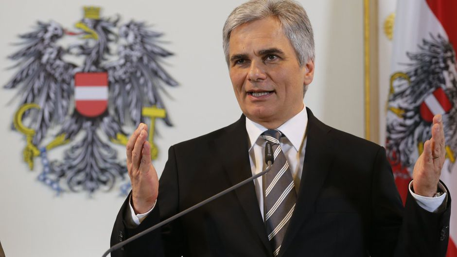 Austrian Chancellor Faymann gestures during a news conference in Vienna