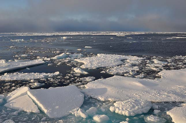 Blue sky begins to break through the clouds over Arctic Ocean ice Sept. 9, 2009.
