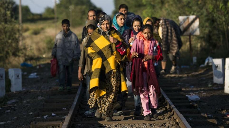 migrants1-965x543