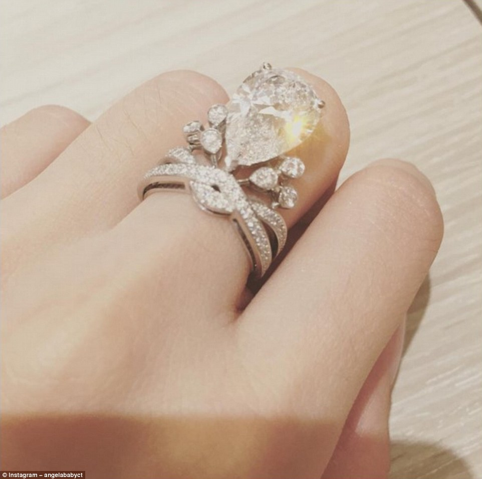 2D83FA0100000578-3277016-Sparkling_Angelababy_s_wedding_ring_an_enormous_six_carat_diamon-a-57_1445127907500