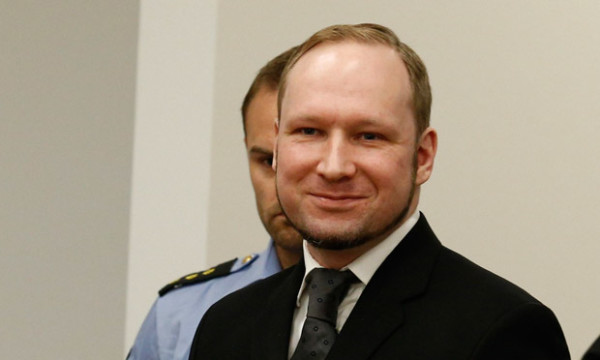 Anders Behring Breivik smiling in court