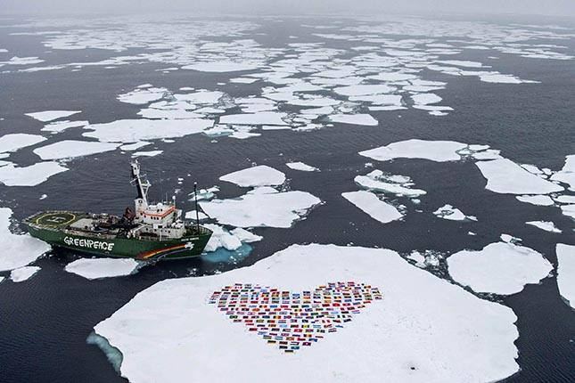 "The crew of the Greenpeace ship My Arctic Sunrise construct a heart with the flags of the 193 country members of the United Nations on an ice floe north of the Arctic Circle on September 14, 2012.The 'heart' of flags is suspended by wires a few centimetres from the ice surface and symbolises an emotional appeal for united global action to protect the Arctic'.Greenpeace International is hosting an event in New York on the eve of the UN General Assembly which will present the latest science on changes in the Polar regions and then discuss an appropriate response from the international community.IMAGE AVAILABLE FOR DOWNLOAD BY EXTERNAL MEDIA FOR 14 DAYS AFTER RELEASE - RESTRICTED TO EDITORIAL USE - MANDATORY CREDIT ""AFP PHOTO / GREENPEACE INTERNATIONAL / DANILE BELTRA "" - NO MARKETING NO ADVERTISING CAMPAIGNS - DISTRIBUTED AS A SERVICE TO CLIENTS -- NO ARCHIVE --"