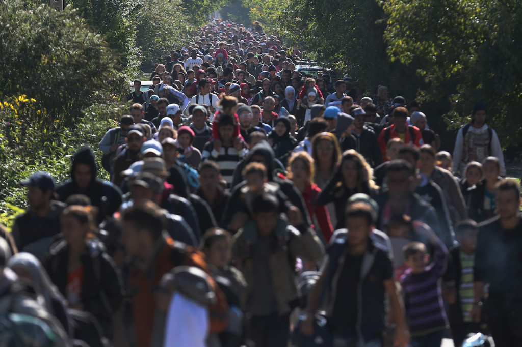 Migrants Cross From Hungary Into Austria On Route To Northern Europe