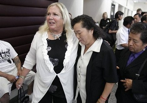 Linda Parisi, left, the court appointed attorney for Ka Yang, who is facing charges for allegedly killing her 6-week-old daughter, leaves the courtroom with Yang's mother, Chuoa Yang, after a hearing in Sacramento County Superior Court Sacramento, Calif., Wednesday, Aug. 3, 2011. No action was taken during the hearing as Parisi is waiting for evidence through discovery. Ka Yang has not entered a plea in the death of her daughter who authorities believe died from burns suffered inside a microwave oven. (AP Photo/Rich Pedroncelli)