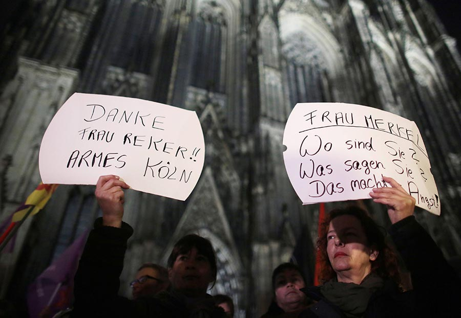 epa05088840 Women protest against sexism outside the cathedral in Cologne, Germany, 05 January 2016. After assaults on women outside Cologne main station at New Year, little is currently known about the perpetrators. EPA/OLIVER BERG