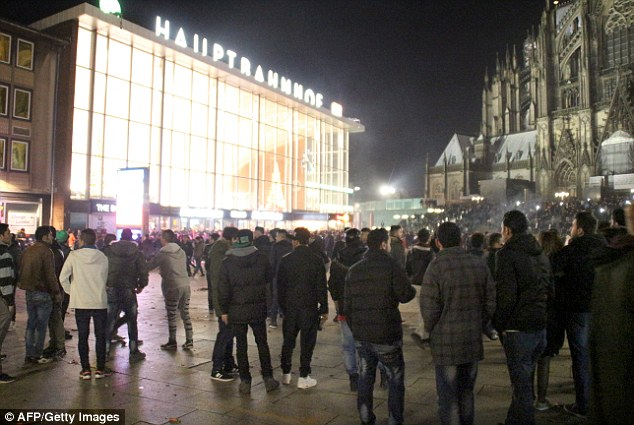 2FD6943900000578-3386673-Hundreds_of_people_gather_in_front_of_Cologne_s_main_railway_sta-a-83_1452116055318