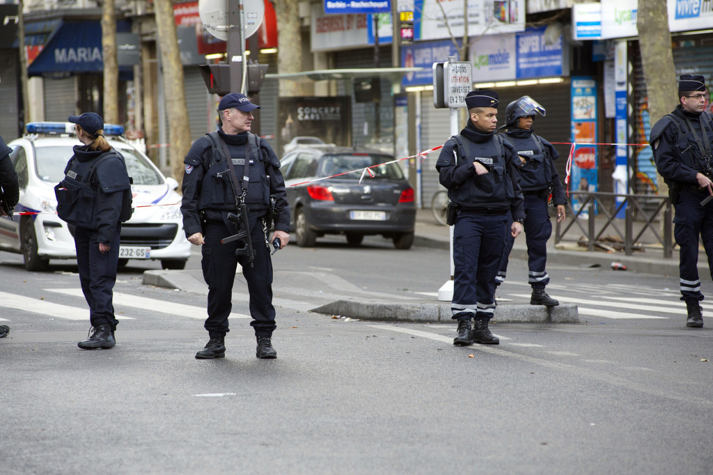 FRANCE, Paris: Police officers of the French national police stand armed near the Rue de la Goutte d'Or in northern Paris, on January 7, 2016, after police shot dead a man who attempted to attack a police station. French police shot dead a knife-wielding man on January 7 as he attacked a police station in Paris, a year to the day since jihadist gunmen killed 12 people at Charlie Hebdo newspaper. - CITIZENSIDE/PATRICE PIERROT
