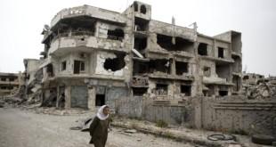 APTOPIX Mideast Syria Returning to Homs