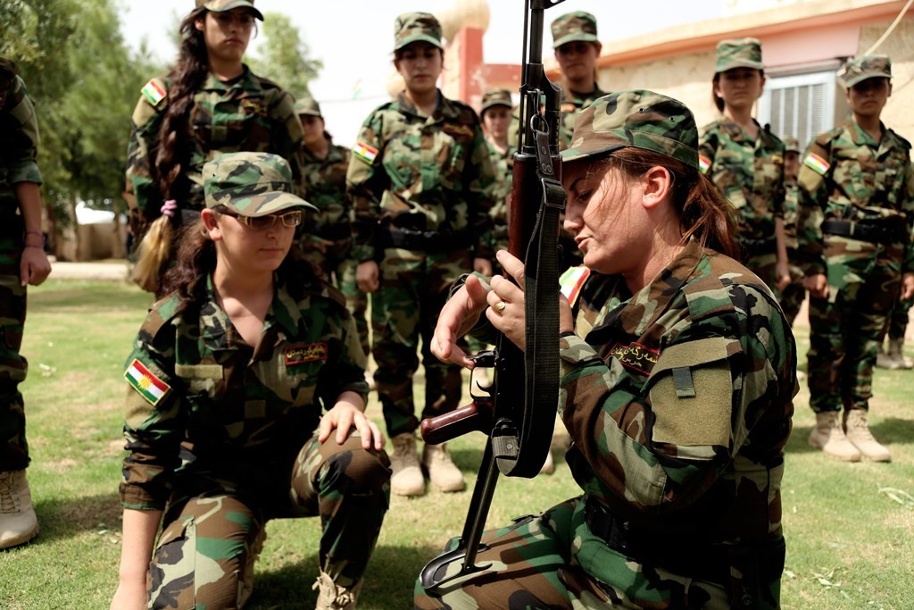 "DOHUK, IRAQ - SEPTEMBER 10: Iraqi Yezidi women are seen during a military training in the garden of the Yezidi Conference Hall in Sahriya, Dohuk on September 10, 2015. Yezidi women in Iraq have armed themselves against Daesh terrorist organization. A troop taught by the Peshmerga called the ""Daughters of the Sun Command"" and formed of Yezidi women aged 18-30 underwent training. Emrah Yorulmaz / Anadolu Agency"