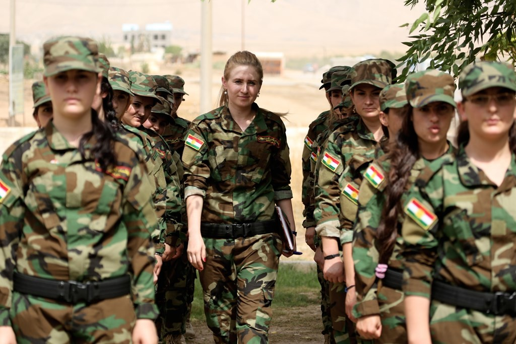 """DOHUK, IRAQ - SEPTEMBER 10: Iraqi Yezidi women are seen during a military training in the garden of the Yezidi Conference Hall in Sahriya, Dohuk on September 10, 2015. Yezidi women in Iraq have armed themselves against Daesh terrorist organization. A troop taught by the Peshmerga called the """"Daughters of the Sun Command"""" and formed of Yezidi women aged 18-30 underwent training. Emrah Yorulmaz / Anadolu Agency"""
