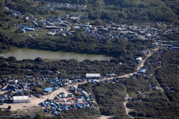 "An aerial view of a field called the ""New Jungle"" with tents and makeshift shelters where migrants and asylum seekers stay is seen in Calais,"