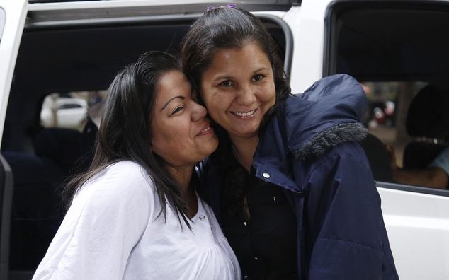 Jacqueline Vasquez Sanchez, left, embraces her sister Lorena Sanchez, right, before a press conference in Bogota, Colombia, Thursday, Feb. 25, 2016. The reunited sisters were separated more than 30 years ago, when on November 13, 1985, the Nevado del Ruiz volcano erupted triggering a deluge of mud and debris that buried the town of Armero, killing more than 25,000 people in and around the town. (AP Photo/Fernando Vergara)
