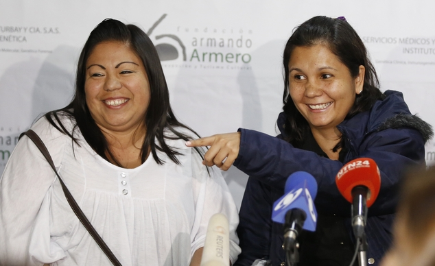 Jacqueline Vasquez Sanchez, left, and her sister Lorena Sanchez, right, smile during a press conference in Bogota, Colombia, Thursday, Feb. 25, 2016. The reunited sisters were separated more than 30 years ago, when on November 13, 1985, the Nevado del Ruiz volcano erupted triggering a deluge of mud and debris that buried the town of Armero, killing more than 25,000 people in and around the town. (AP Photo/Fernando Vergara)