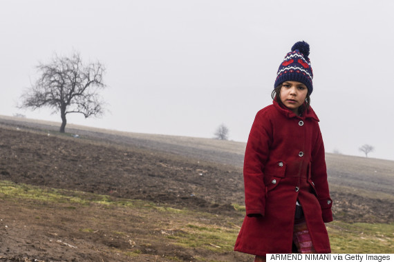 A girl walks with other migrants after crossing the Macedonian border into Serbia, near the village of Miratovac, on January 29, 2016. More than one million people reached Europe's shores in 2015 -- the majority of them refugees fleeing conflict and persecution in Syria, Afghanistan and Iraq -- in the continent's worst migration crisis since World War II. The International Organization for Migration estimates that some 31,000 migrants have reached Greece by sea so far this year, hoping to start new lives in Germany, Sweden and elsewhere in the European Union. / AFP / ARMEND NIMANI (Photo credit should read ARMEND NIMANI/AFP/Getty Images)