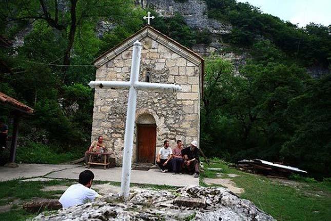 Father Maxime Kavtaradze talks to his acolytes