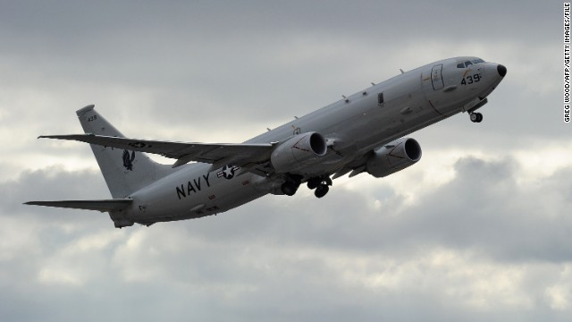 "A US Navy P-8 Poseidon aircraft flies out from Perth International Airport on April 16, 2014 to help in the search for missing Malaysia Airlines flight MH370. Meanwhile, a mini-sub searching for missing Flight MH370 was again sweeping the Indian Ocean seabed on April 16 after aborting its first mission, officials said, as Malaysia vowed to reveal any ""black box"" data found. AFP PHOTO / POOL / Greg WOOD (Photo credit should read GREG WOOD/AFP/Getty Images)"