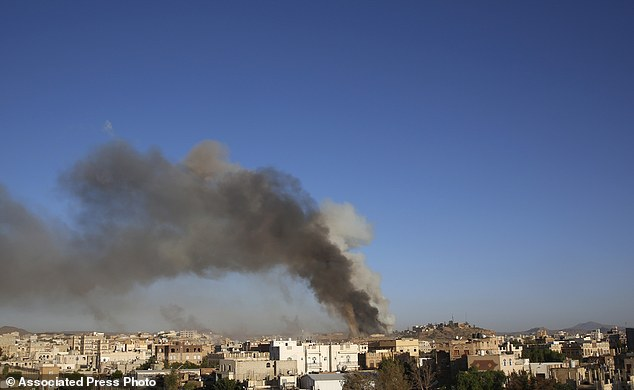 FILE -- In this Sept. 11, 2015 file photo, smoke rises after an airstrike by the Saudi-led coalition at a weapons depot in Sanaa, Yemen. Hunger has been the most horrific consequence of Yemen's conflict and has spiraled since Saudi Arabia and its allies, backed by the U.S., launched a campaign of airstrikes and a naval blockade a year ago. (AP Photo/Hani Mohammed, File)