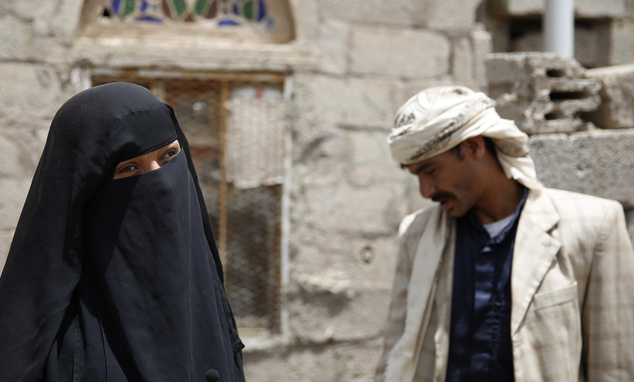 In this Monday, March 28, 2016 photo, Intissar Hezzam stands with her husband Faisal Ahmed, whose son, Udai, died of severe acute malnutrition, as she speaks to The Associated Press near her house in Hazyaz village, on the southern outskirts of Sanaa, Yemen. The day Udai was born, warplanes from the Saudi-led coalition were striking an army base used by Houthi rebels in their district of Hazyaz. Hunger has been the most horrific consequence of Yemen's conflict and has spiraled since Saudi Arabia and its allies, backed by the U.S., launched a campaign of airstrikes and a naval blockade a year ago. (AP Photo/Hani Mohammed)